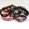 Jiayiqi 2017 New 50PCS Peace Butterfly Skull Cross Mix Genuine Leather Bracelet Random Color And Model Bracelet Men