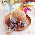 De moda de Corea Primavera verano flores Hechas A Mano de paja sombrero de Los Niños de los bebés Sombreros de Playa plegable niños sombrero para el sol