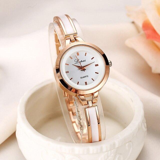 2018 mujeres elegante pulsera reloj de cuarzo de oro plata vestido de las mujeres  relojes señoras ce7e40a089d5