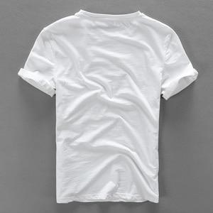Image 2 - Camiseta para hombre de manga corta de lino con costura bordada de dibujos animados, camiseta informal de la marca con cuello redondo de algodón blanco elástico para hombre