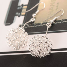 Korean version hot sale with simple wire ball hollow long earrings lady