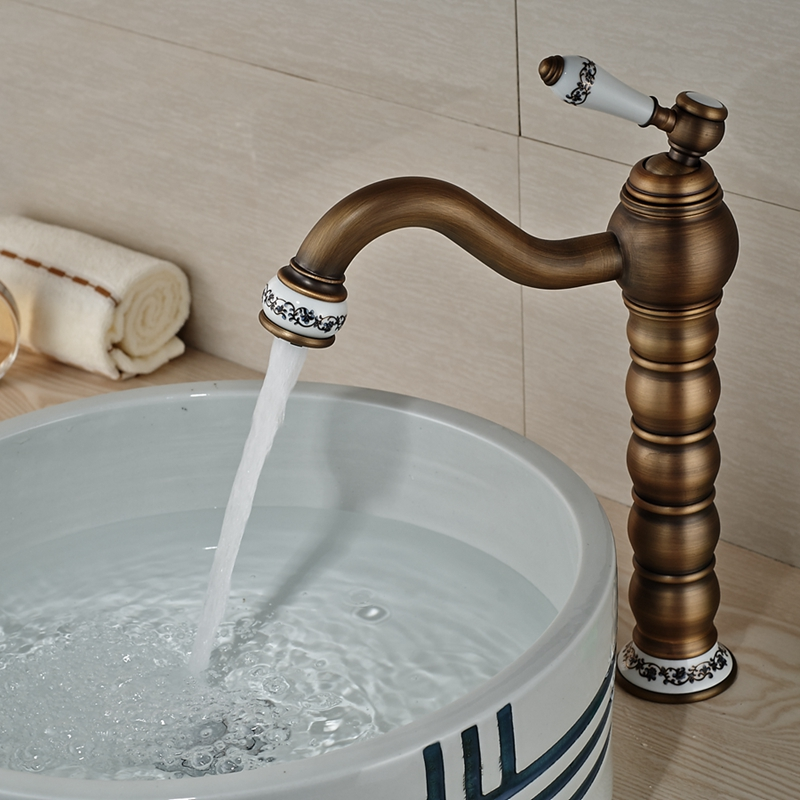 Wholesale And Retail Modern Antique Brass Bathroom Basin Faucet Ceramic Base Vessel Sink Mixer Tap Hot and Cold Water  antique bathroom vanity sink faucet single ceramic handles brass hot and cold basin mixer copper pop up drain
