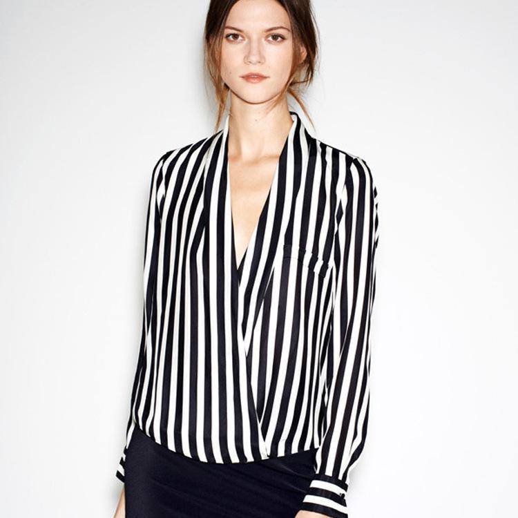 V neck long sleeved black and white vertical striped shirt ...