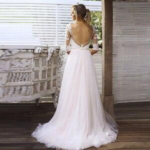 Image 3 - Half Mouwen Bridal Dress V hals Lace Tulle Rok Backless Trouwjurken Vestido De Novia 2019 Bruidsjurken Gelinlik