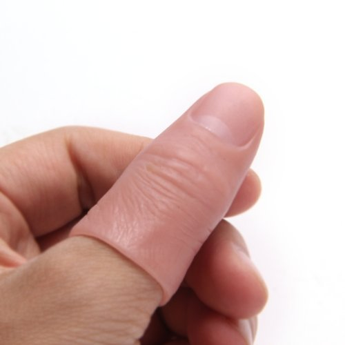 Magic trick with thumb tip