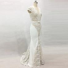 Vestido de novia RSW1418 Yiaibridal con mangas de casquillo de trabajo pesado con cuentas encaje de Venecia sin espalda trowwjurk
