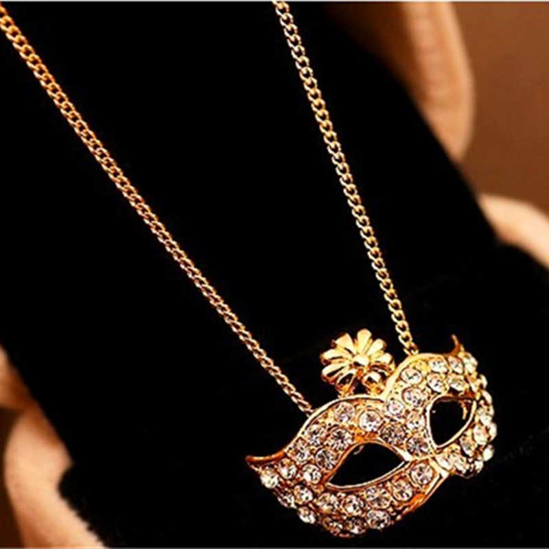 X76 ใหม่ Gold สีการออกแบบหน้ากากจี้สร้อยคอยาวสำหรับผู้หญิง Charming Shining คริสตัลหน้ากากจี้สร้อยคอขายส่ง