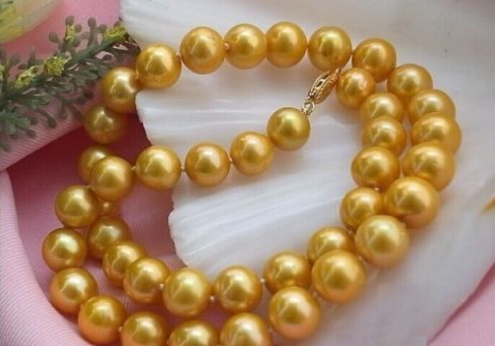 Le plus populaire naturel 10-11mm AAA mer du sud jaune collier de perles 18
