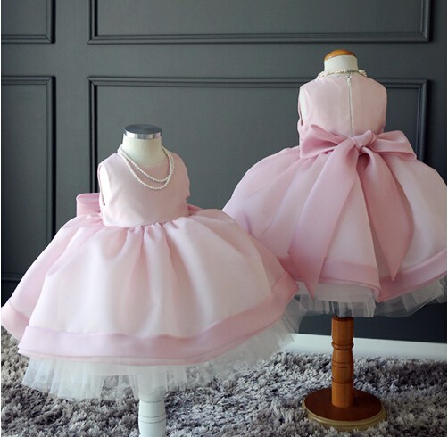 Фотография Knee Length Pink Infant Girls Birthday Dress with Bow Flower Girls Dresses for Wedding Custom Size