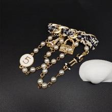 цена на CX-Shirling Women Antique Brooch Pins Lady Handbag Tower Vintage Gold Chain Tassel Brooch Pin Female All Match cc Broach Pin