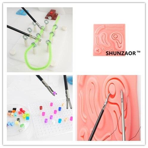 Module de pratique de la suture 3D avec clip et module de perforation