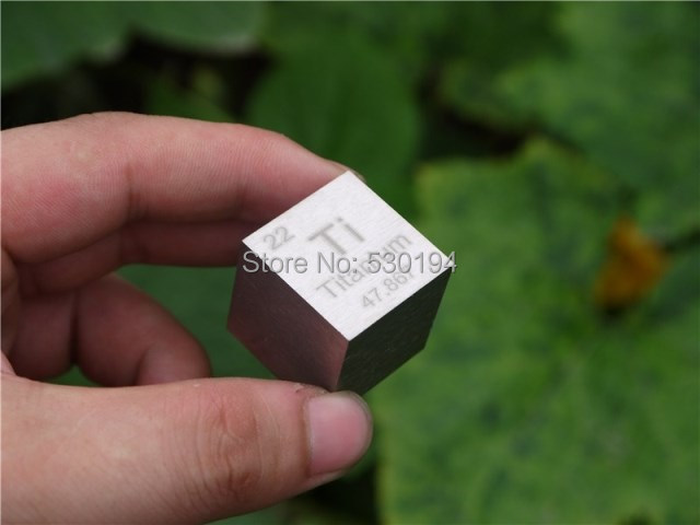 Titanium metal in the periodic table- Cube one inches and weight is about 73.76g --99.5%