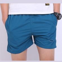 Nueva llegada de los hombres playa pantalones cortos pantalones cortos de cintura elástica de moda mid loose básica aptitud longitud de la rodilla pantalones de los hombres de alta calidad