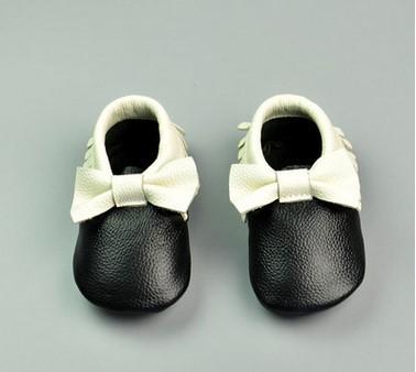 Nuevo 2017 de cuero de Vaca Arco bebé mocasines Borla para Niños niñas zapatos de bebé para caminar en interiores zapatos de suela suave primeros caminante de Prewalker