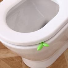 Hot 1Pcs Long Green Leaves Toilet Lid Lifting Device Sitting Commode Bathroom Accessories Toilet Handle Portable Sanitation