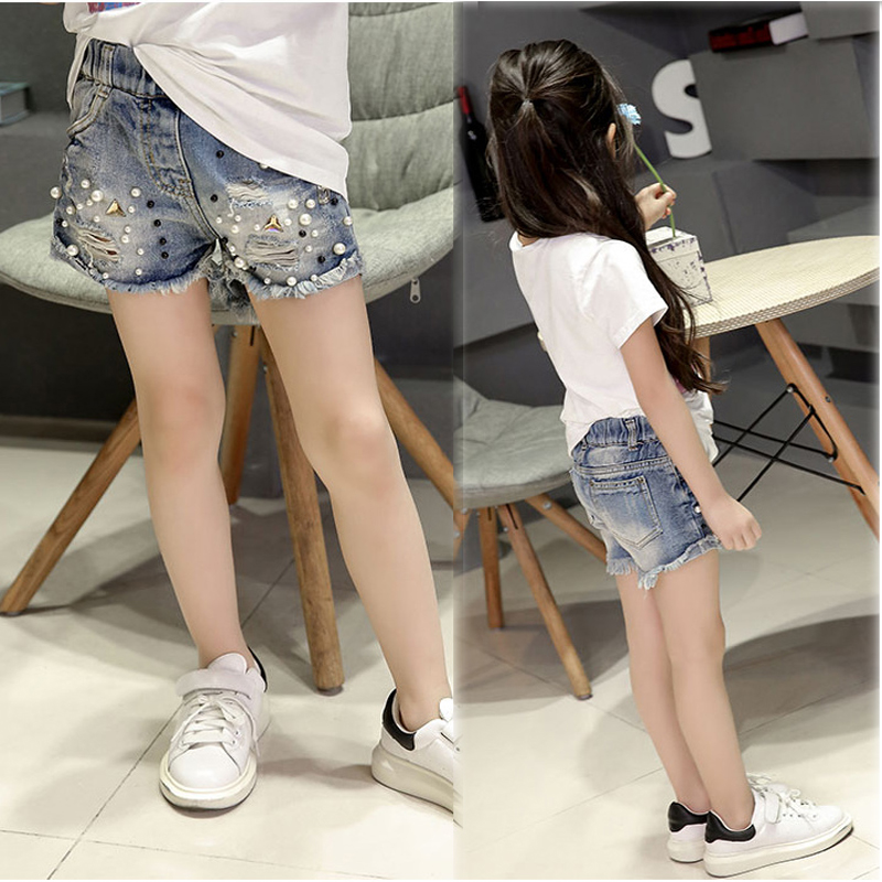 2018 Spring and summer new girls denim shorts Korean children's wild washed broken flash edge hot pants