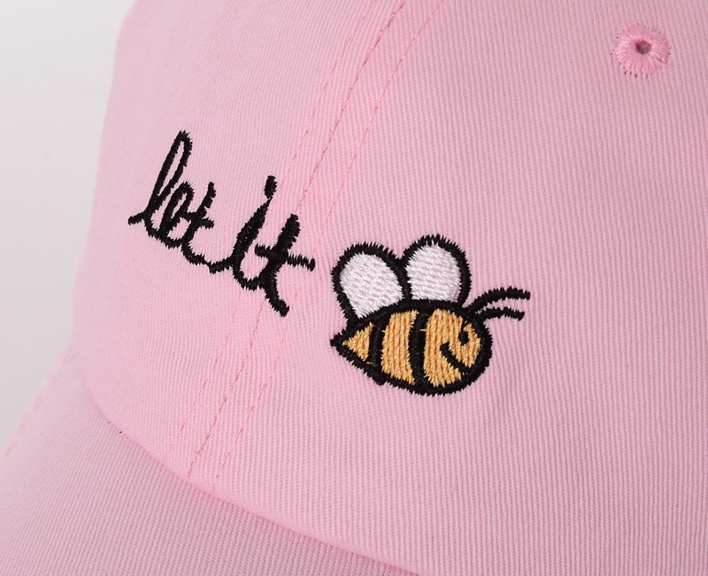 "Let It Bee Baseball Cap - Pink Cap Embroidery Detail of ""let it"" Text and Bumble Bee"
