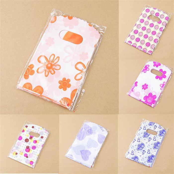 100pcs/Lot 14X9CM Plastic Packaging Bags With Handle Small Gift Bags title=