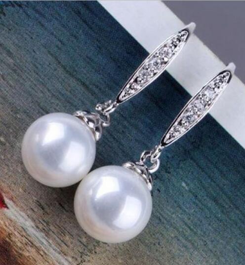 купить Free Shipping unique natural round 10mm Australian south sea white pearl earrings 925silver по цене 5017.54 рублей