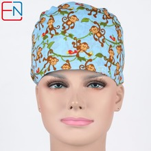unisex dentist caps,thin material ,surgical caps in light blue,monkeys on the branch