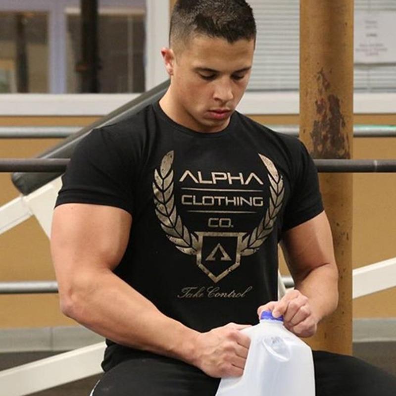 Vīriešu vasaras kokvilnas īsās piedurknes t-kreklu trenažieri Fitnesa kultūrisms T-krekli Jauns O-kakls Zīmols tee topi Modes gadījuma druka