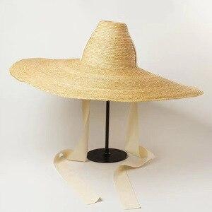 Image 1 - נשים טבעי ארוג ענק קש כובע גדול ברים תקליטונים שמש כובע גבוהה למעלה סרט להקת ענק ג מבו סומבררו כובע למבוגרים קיץ חוף כובע