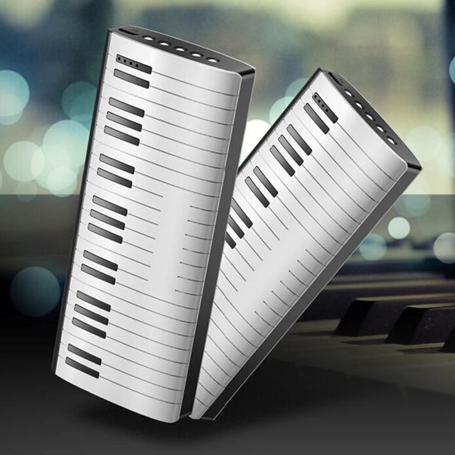 Inovador em forma de piano 5 iluminação led 12000 mah promocional banco de potência para o iphone para samsung pc de mesa telefone móvel todos