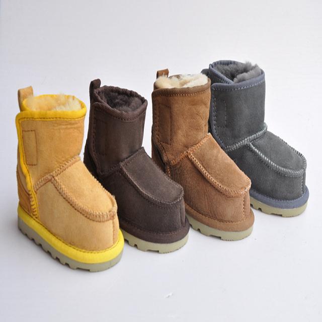 2016 Atacado Manter Criança Quente Sapatos de Couro de Pele de Um Anti-slip Sola de Borracha Cor Sólida Moda Botas de Neve 2 pares/lote