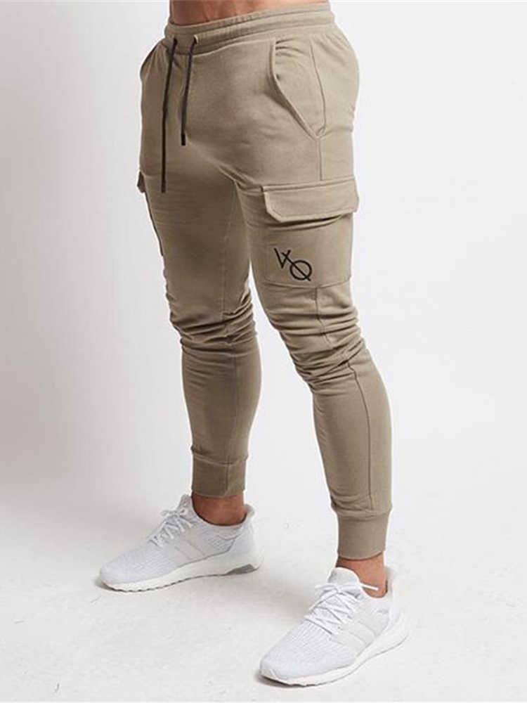 9be80ed5d69 ... Для мужчин брюки 2018 осень Для мужчин брюки Для Мужчин s Штаны Фитнес  пот Штаны тренажерные залы ...