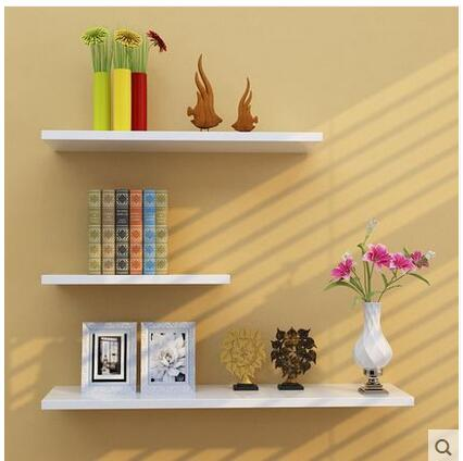 The wall is set up on the wall shelf bedroom multiple bookshelf is free of perforative simple modern adornment  shelf