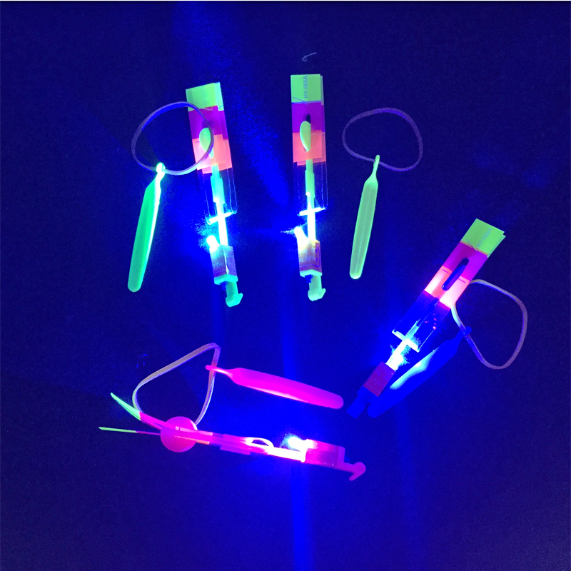 2018 Real 100pcs/lot Amazing Flashing Led Arrow Rocket Helicopter Rotating Flying Toys Light Up For Kids Party Decoration Gift
