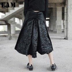 [EAM] تنورة جديدة ربيعية موديل 2020 بخصر عالٍ بطيات سوداء وظهر مجزأة تنورة قصيرة فضفاضة بنصف الجسم للنساء موضة المد JL458
