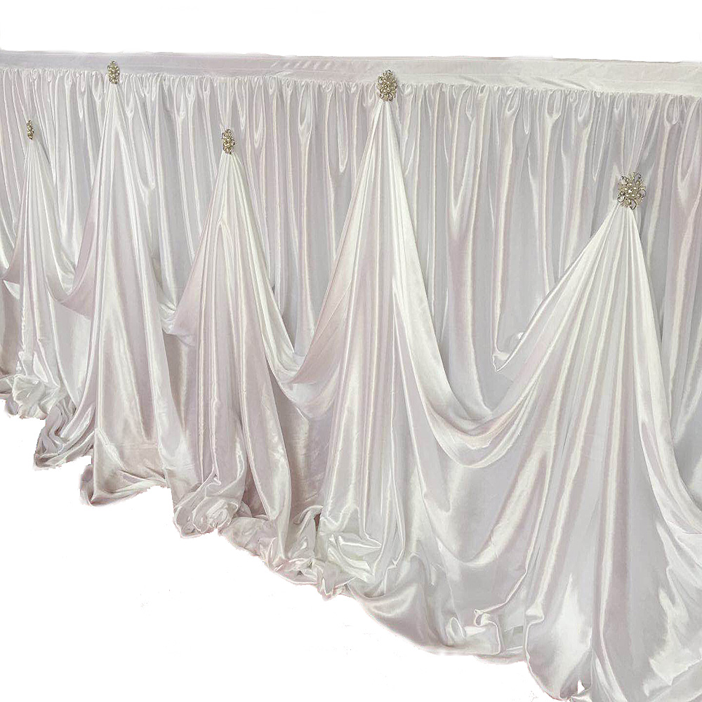 Top Selling White Ice Silk  Gold or Silver Brooch Designed Waved Table Skirt Stage Skirt  Wedding Party Decoration