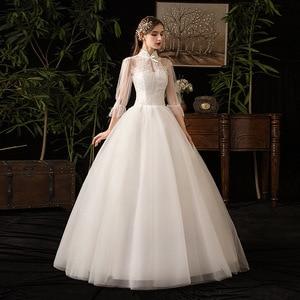 Image 1 - 2019 New High Neck Three Quarter Sleeve Wedding Dress Sexy Illusion Lace Applique Plus Size Vintage Bridal Gown Robe De Mariee L