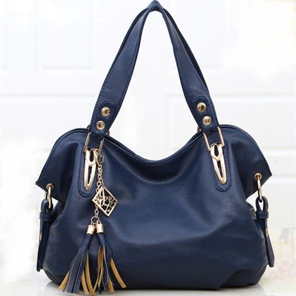 ФОТО New high-capacity portable fringed leather  big handbag ladies fashion women clutch shoulder messenger bag smiley package zx0067