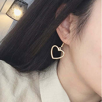Hot sales Korea sweet hollow geometric heart-shaped love earrings cute gold color heart stud earrings For women party earrings 1