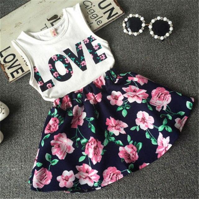 2018 Mùa Hè bé gái quần áo bộ trẻ em Tình Yêu in T-shirt + Hoa Váy 2 pcs phù hợp với trẻ em quần áo đặt 2-7 T