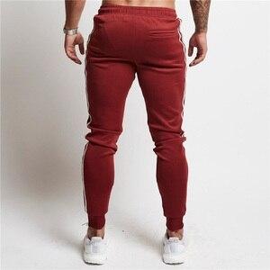 Image 5 - Mens Joggers Casual Pants Fitness Men Sportswear Tracksuit Bottoms Skinny Sweatpants Trousers Black Gyms Jogger Track Pants
