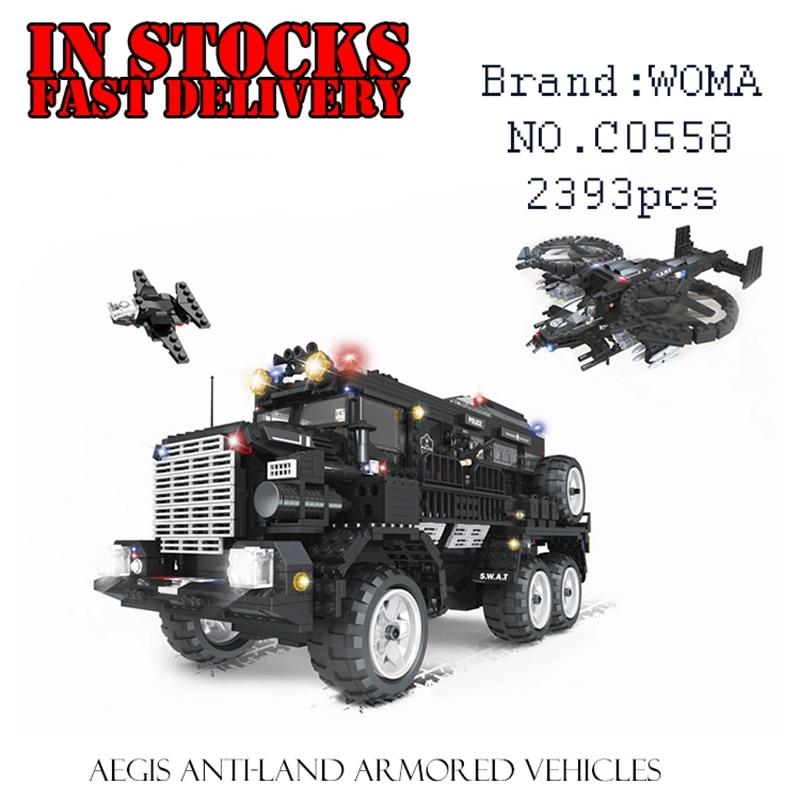 цена на WOMA C0558 SWAT Team Aegis Anti-Riot Armored Vehicles 2393PCS Building Blocks Bricks enlighten toys for children gift brinquedos
