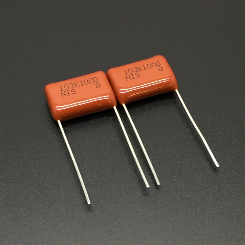 10Pcs/100Pcs Japan NISSEI CBB Capacitor MMC 1000V 103 K 10% 0.01uF 10nF Pitch=12.5mm Metallized Polyester Film Capacitor