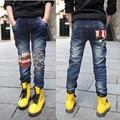 2015 de primavera y otoño nuevos pantalones vaqueros del niño salvaje de 3-15 años de edad bebé coreano pantalones vaqueros de cinco estrellas pantalones