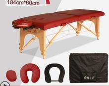 Portable massage bed with folding table.