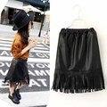 Нью-малышей девушки юбки черный кисточка pu кожаная юбка прохладный all-матч осень / зима девочек одежда