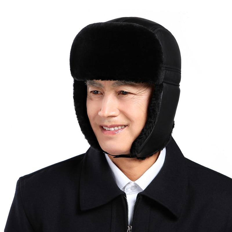 Svadilfari vente en gros nouveau 2018 hiver en cuir véritable fourrure noir Bomber chapeau pour homme/femme oreille chaud Moto casquettes dôme Gorras Hombre