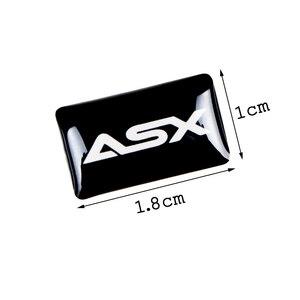 Image 2 - 8pcs רכב סטיילינג הגה 3D קטן סמל מדבקת גלגל מדבקות Fit עבור מיצובישי ASX הנכרי פאג רו לנסר רכב מדבקה