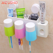 Multifunctional Wall Mounted Toothbrush Holder Suction Cup Automatic Toothpaste Dispenser Cosmetic Storage Box Bathroom Shelf