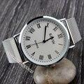 Reloj de pulsera de cuarzo Simple de moda con malla de red de Metal plateado para hombre y mujer Unisex