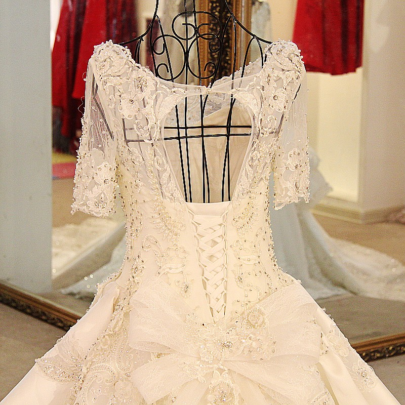 LS54420 Glitter wedding dresses short sleeves lace up back ball gown  rhinestone latest wedding gown designs real photo-in Wedding Dresses from  Weddings ... 0c954b0e7c5f