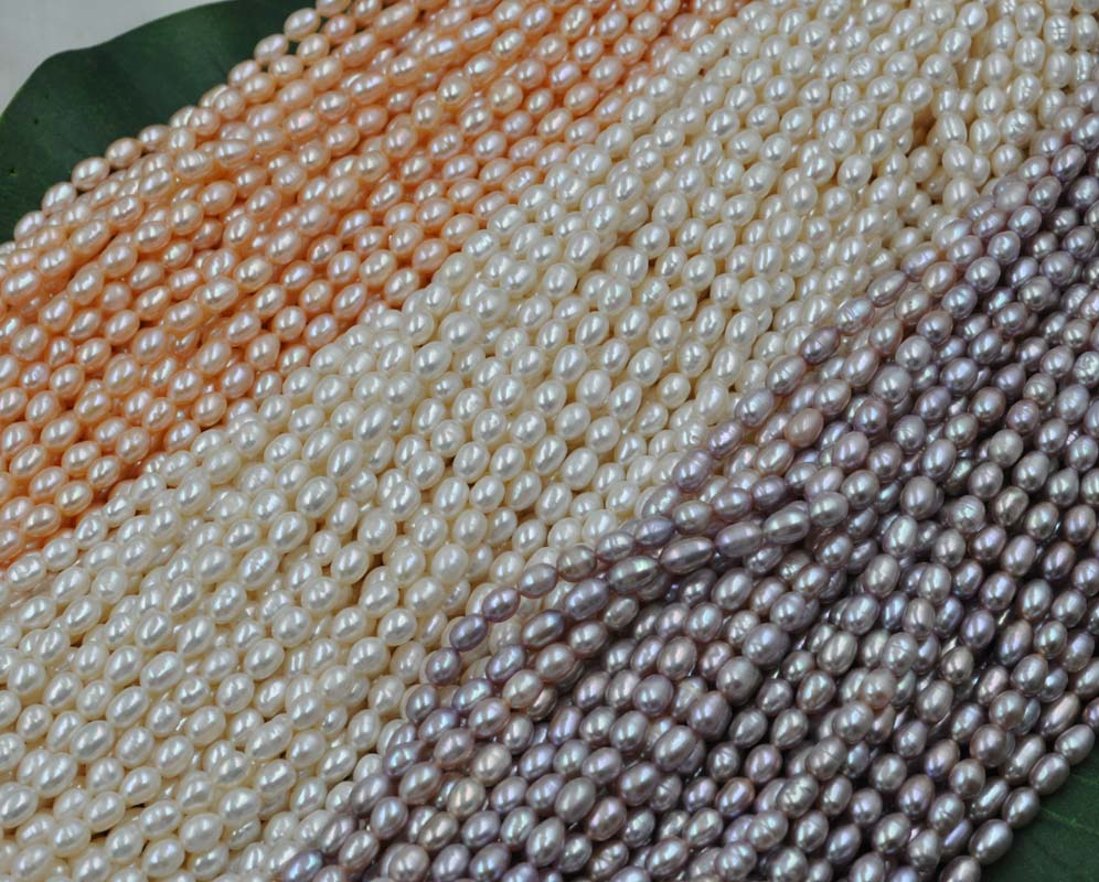 wholesale 12 strands genuine rice freshwater pearl white pink purple