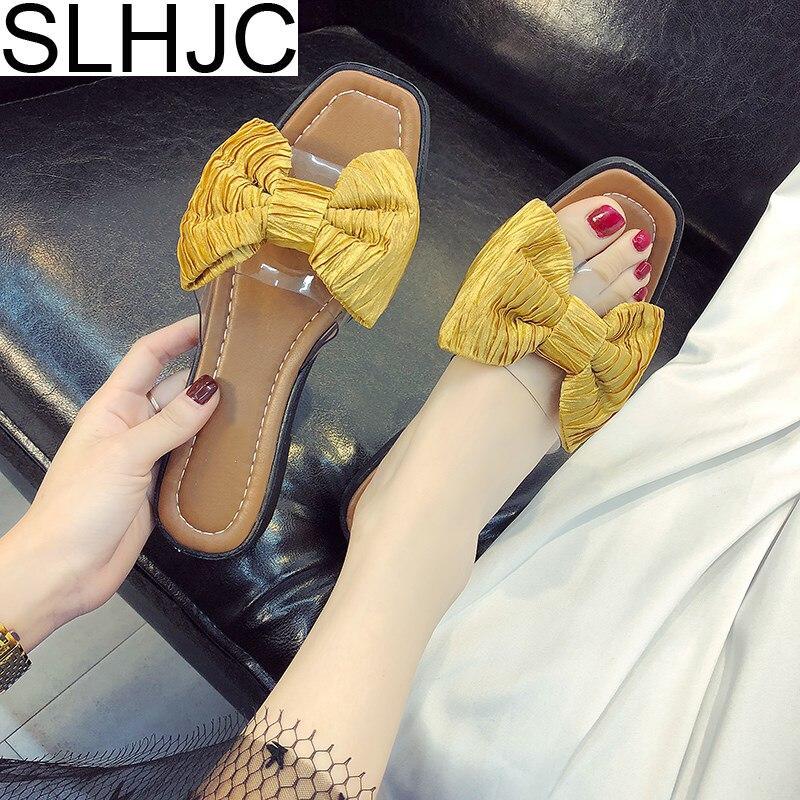 SLHJC Для женщин Летние тапочки с открытым носком плоская подошва шлепанцы пляжная обувь с большой бант босоножки на плоской подошве 2018 Новые